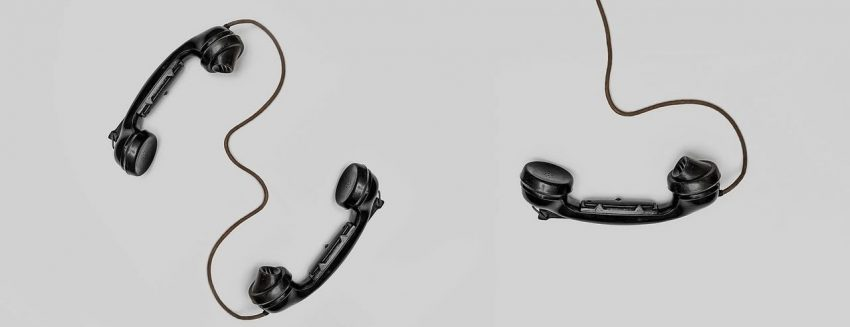 Three phone handsets with cords